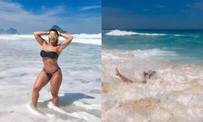 """Viviane Araújo mostra corpão de biquíni fio dental, mas leva """"caldo"""" e cai no mar"""